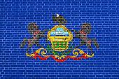 Flag of Pennsylvania brick wall texture background