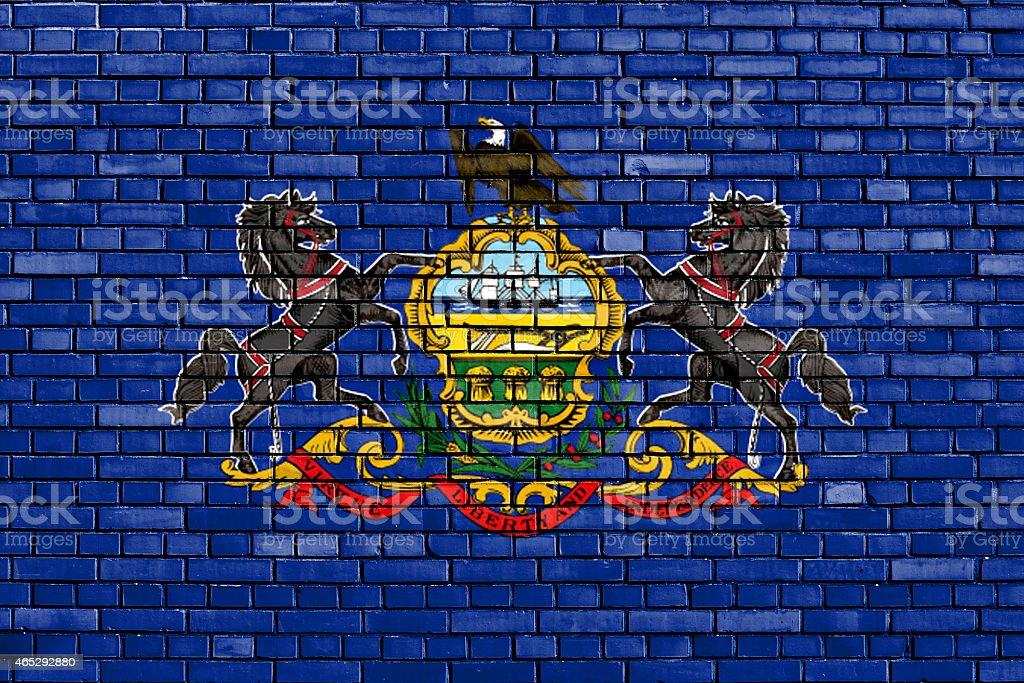 flag of Pennsylvania painted on brick wall stock photo