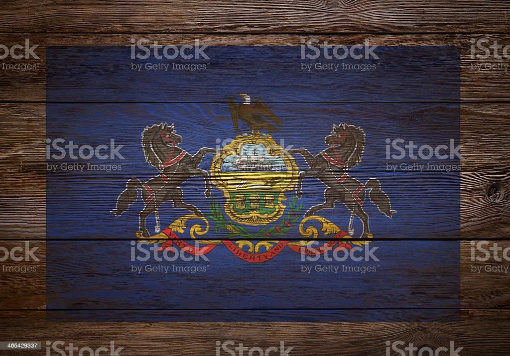 Flag of Pennsylvania stenciled on wood stock photo