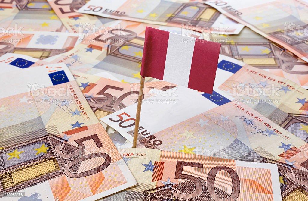 Flag of Peru sticking in 50 Euro banknotes.(series) stock photo