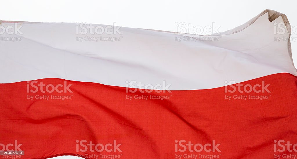 Flag of Poland Waving In a Stiff Wind stock photo