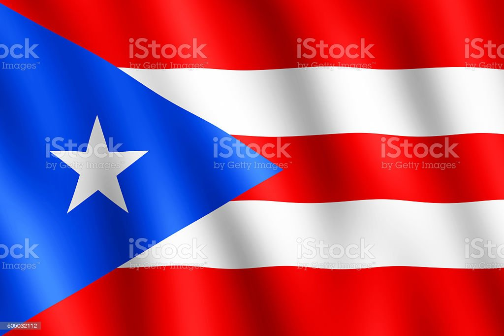 Flag of Puerto Rico waving in the wind stock photo