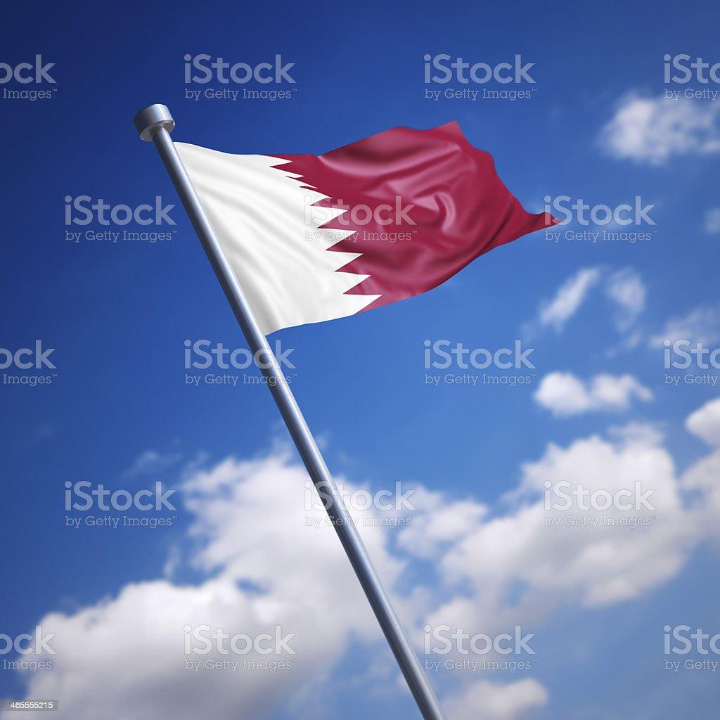 Flag of Qatar against blue sky stock photo