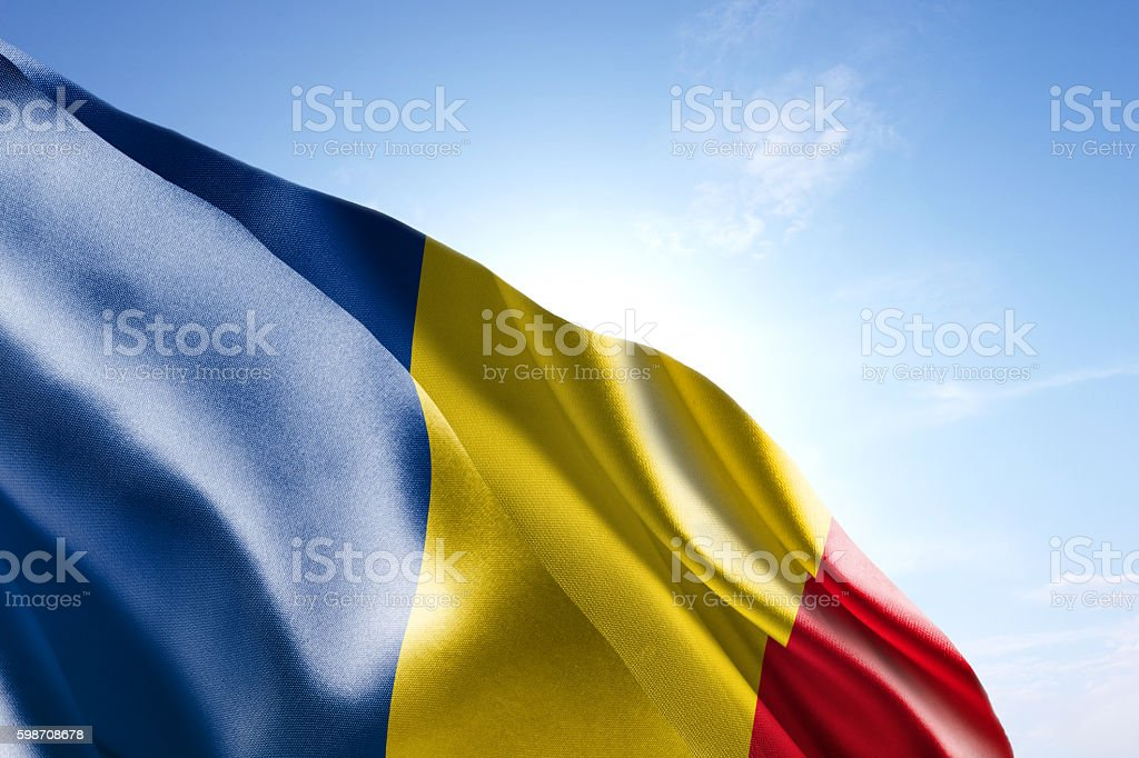 Flag of Romania waving in the wind stock photo