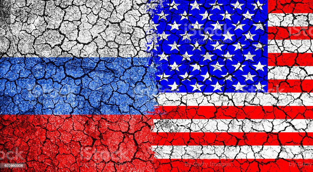 Flag of Russia and USA painted on the cracked wall stock photo