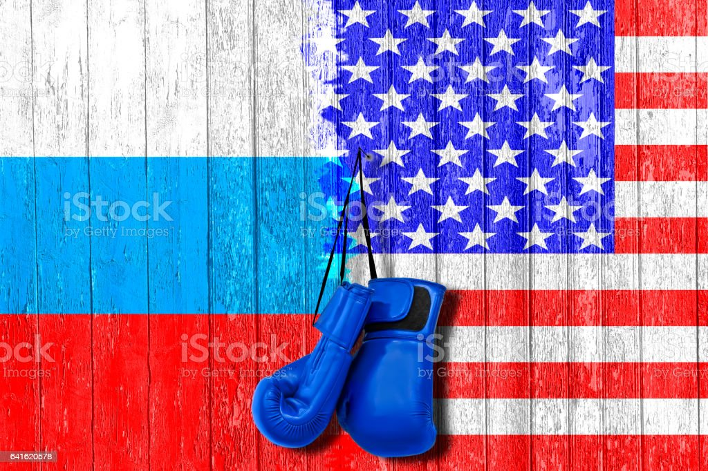 Flag of Russia and USA painted on the wooden board. Arms race and rivalry. The third world war. The conflict between Russia and America. stock photo