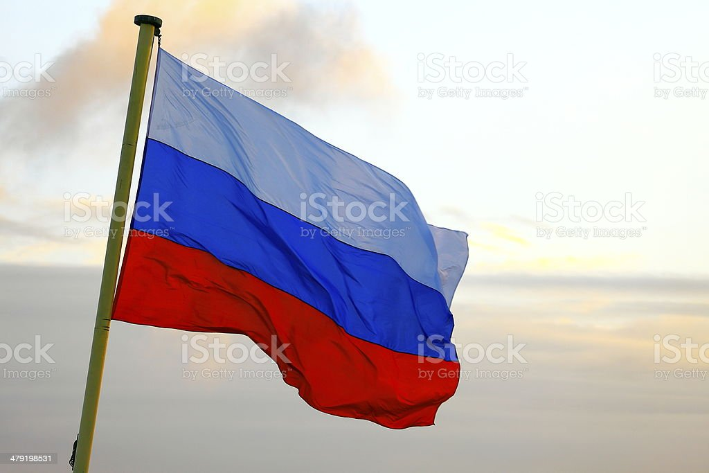 Flag of Russia waving in the wind on sunset, Moscow stock photo