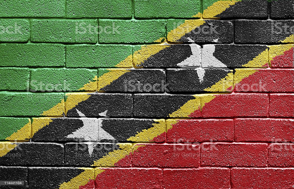 Flag of Saint Kitts and Nevis on brick wall royalty-free stock photo