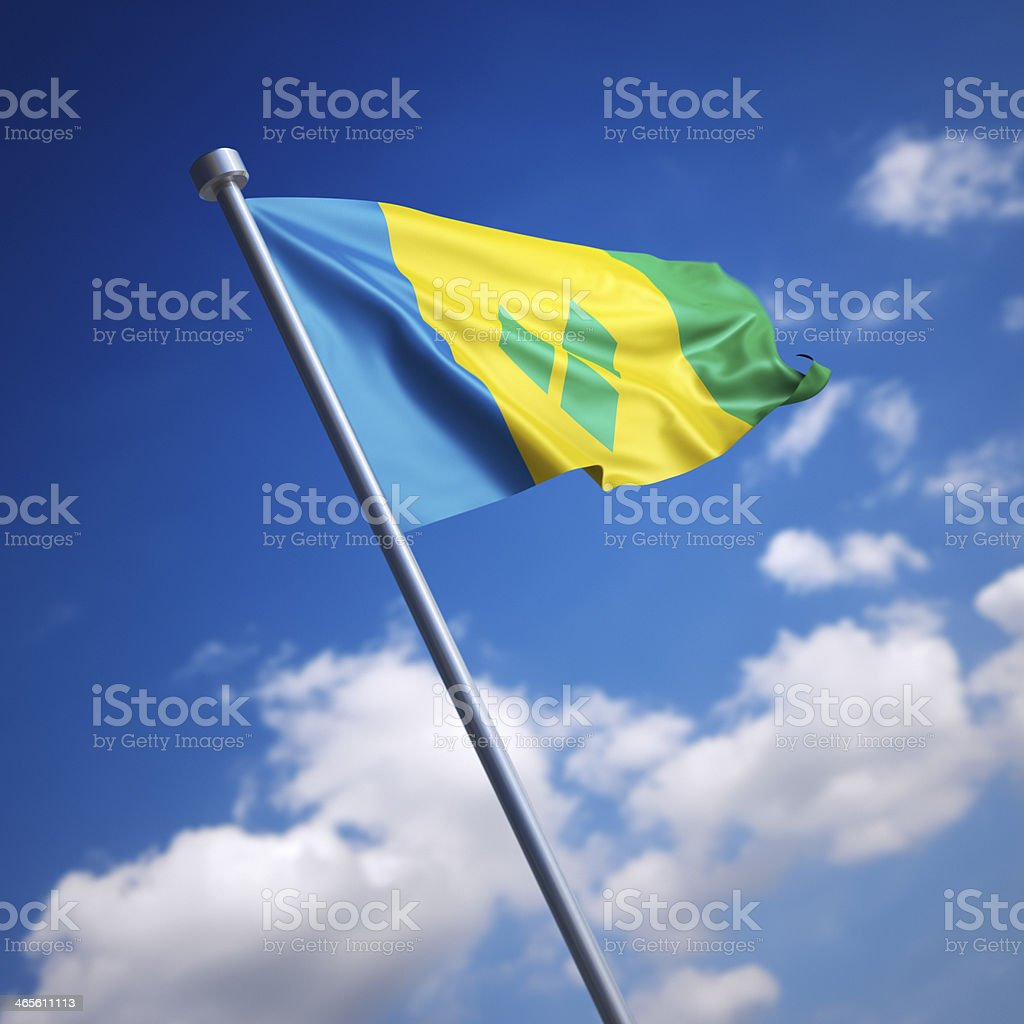 Flag of Saint Vincent and the Grenadines against blue sky stock photo