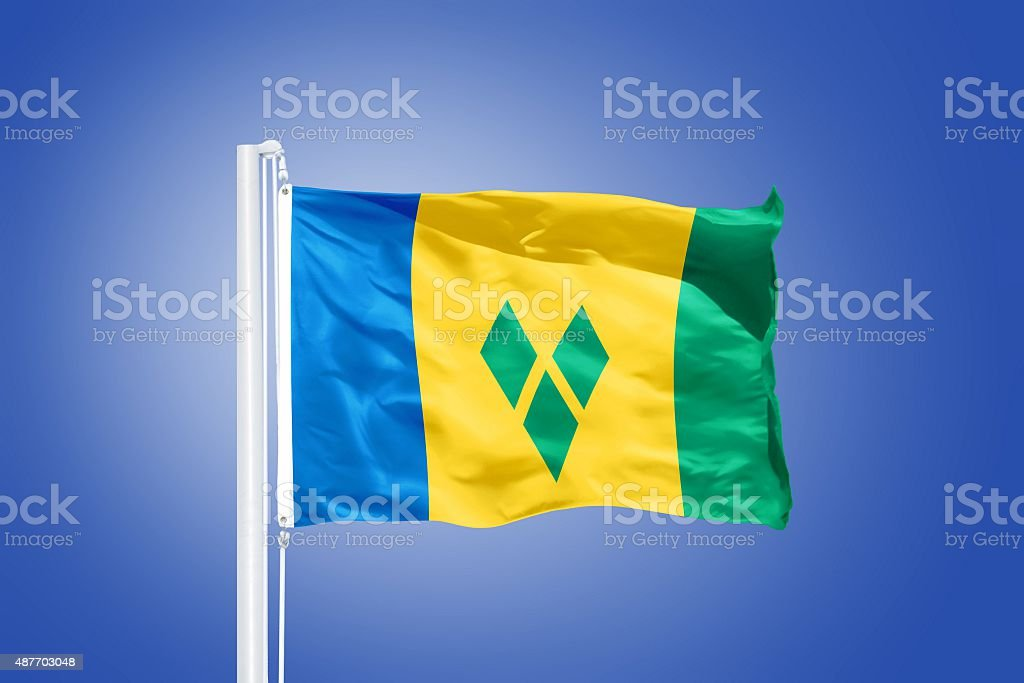 Flag of Saint Vincent and the Grenadines flying stock photo