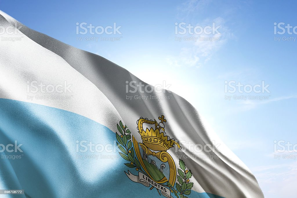 Flag of San Marino waving in the wind stock photo