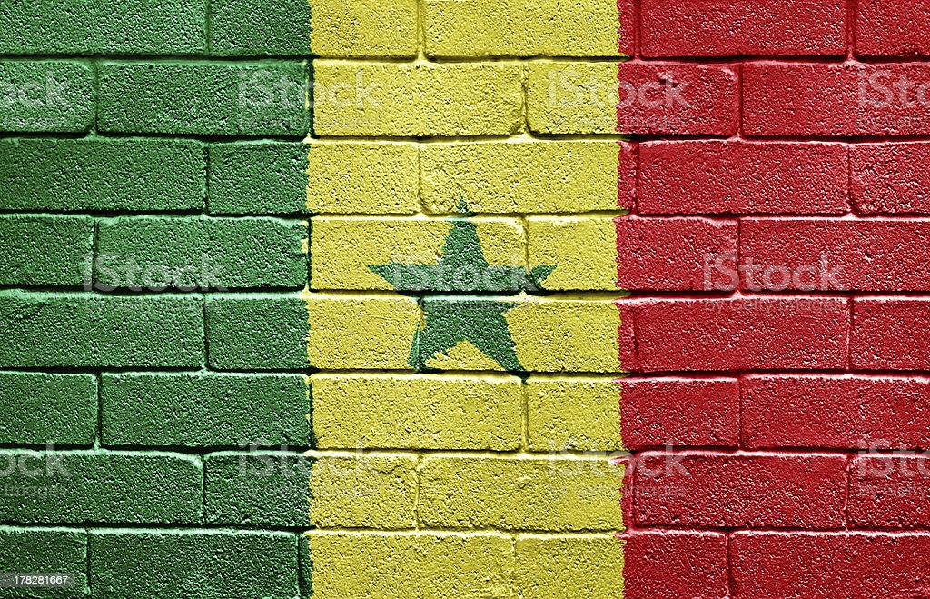 Flag of Senegal on brick wall royalty-free stock photo