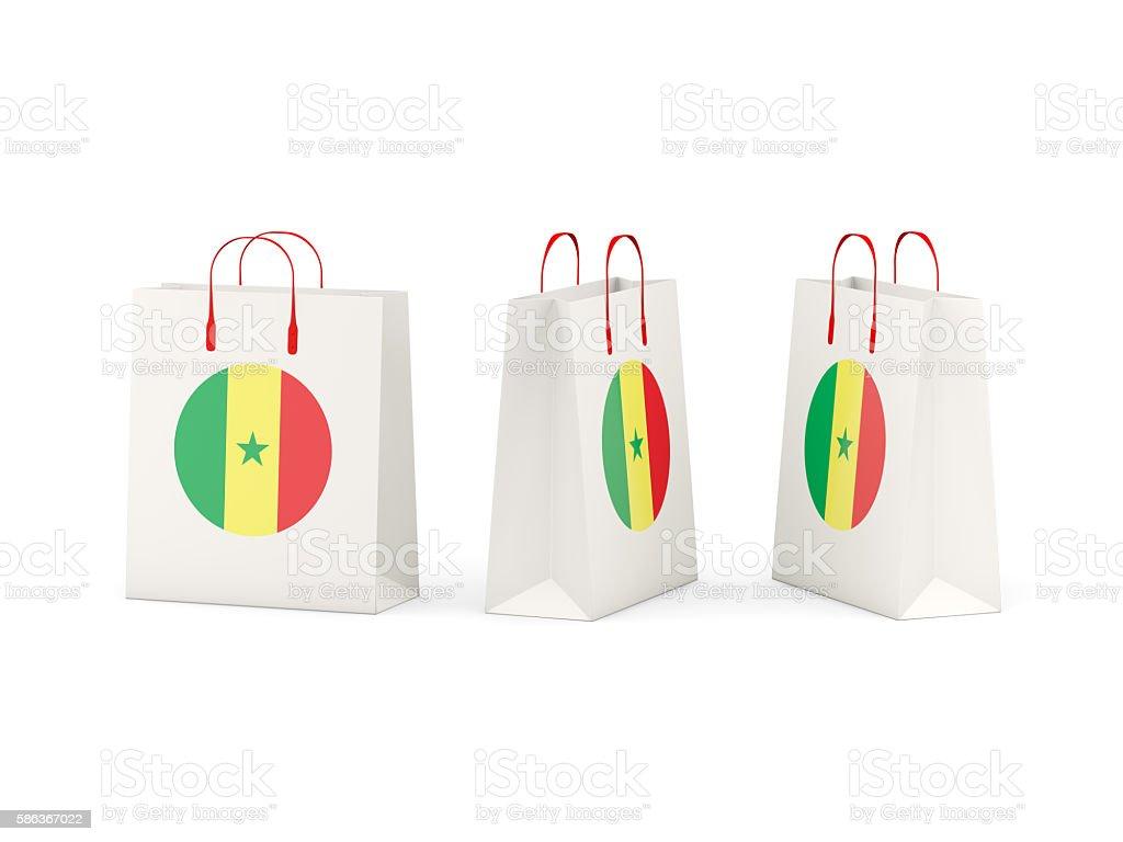 Flag of senegal on shopping bags stock photo