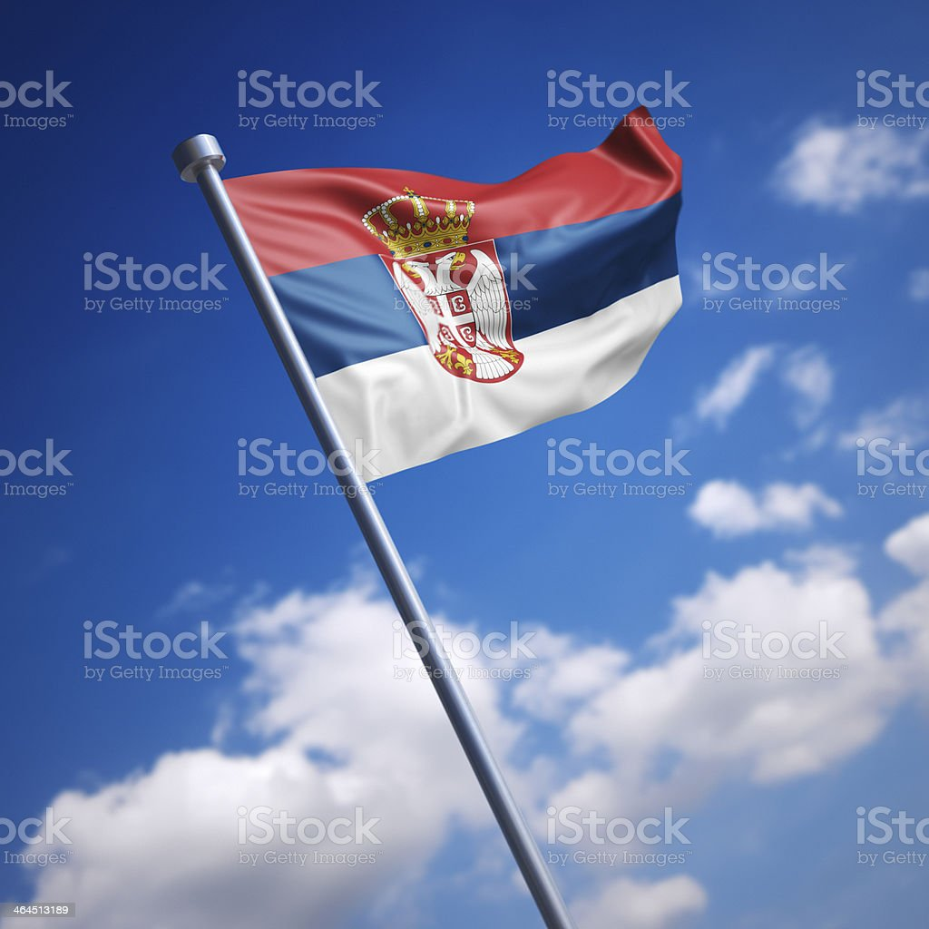 Flag of Serbia against blue sky stock photo