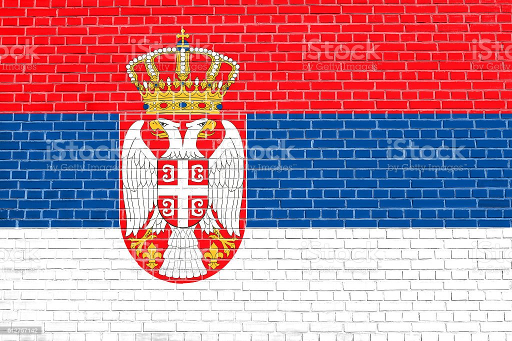 Flag of Serbia on brick wall texture background stock photo