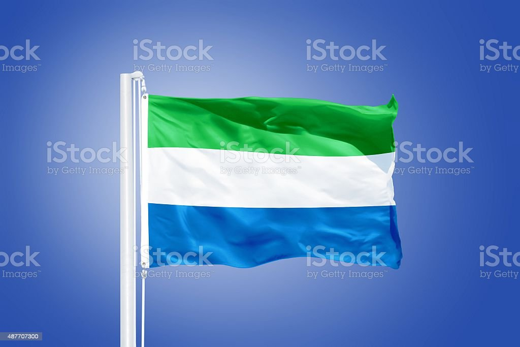 Flag of Sierra Leone flying against a blue sky stock photo