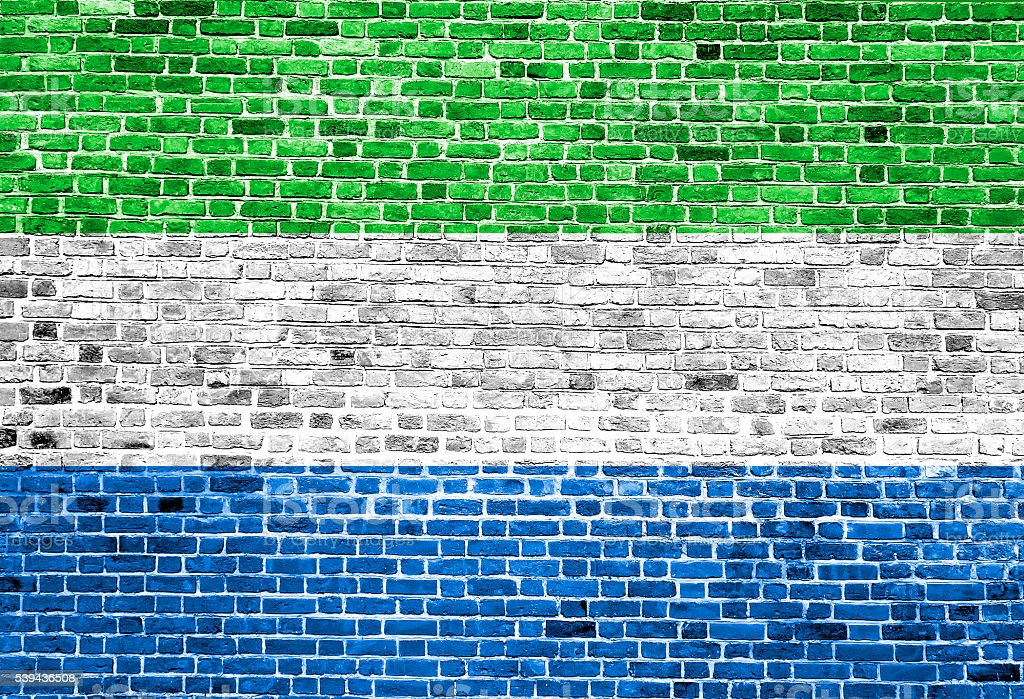 Flag of Sierra Leone painted on brick wall, background texture stock photo