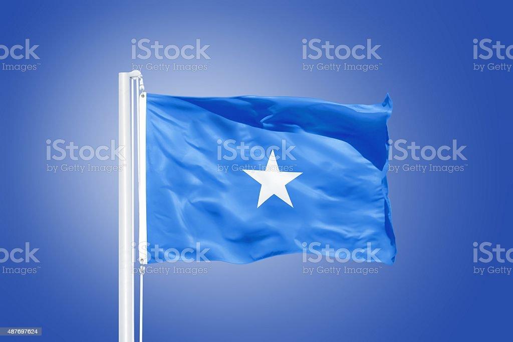 Flag of Somalia flying against a blue sky stock photo
