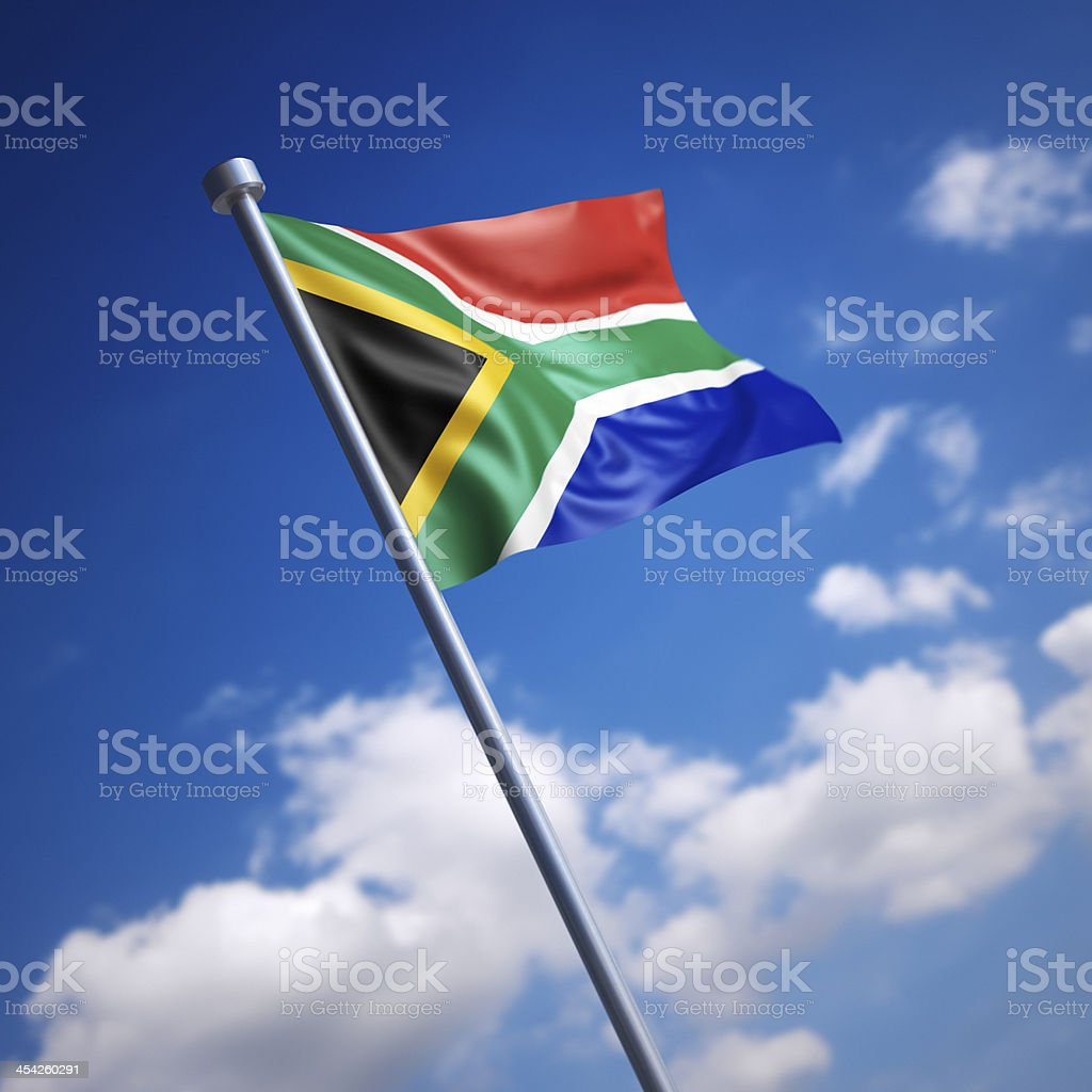 Flag of South Africa against blue sky stock photo