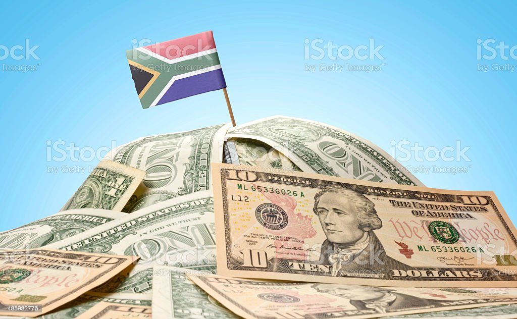Flag of South Africa sticking in american banknotes.(series) stock photo