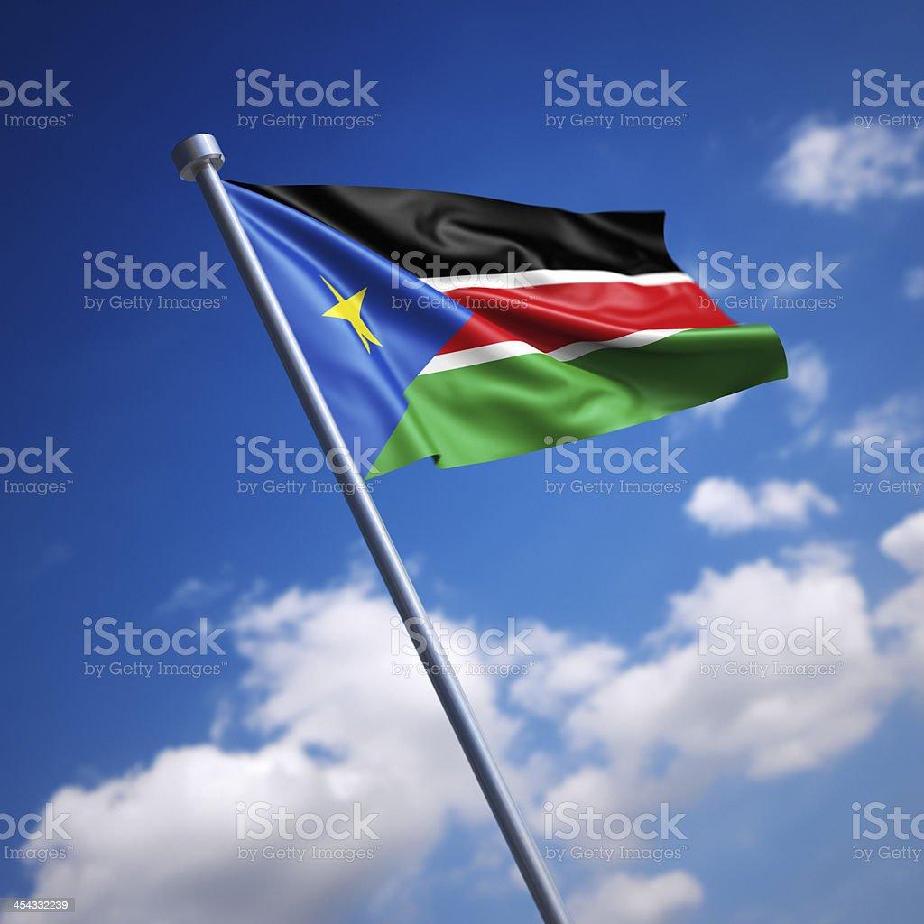 Flag of South Sudan against blue sky stock photo