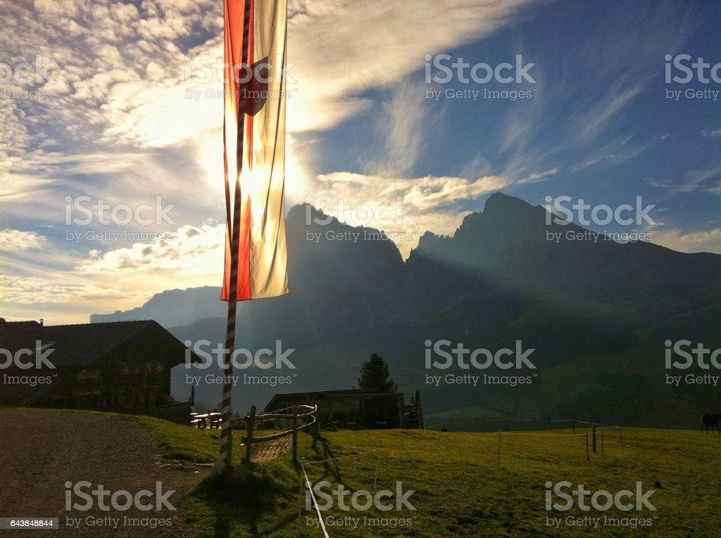 Flag of South Tyrol infront of mountains stock photo