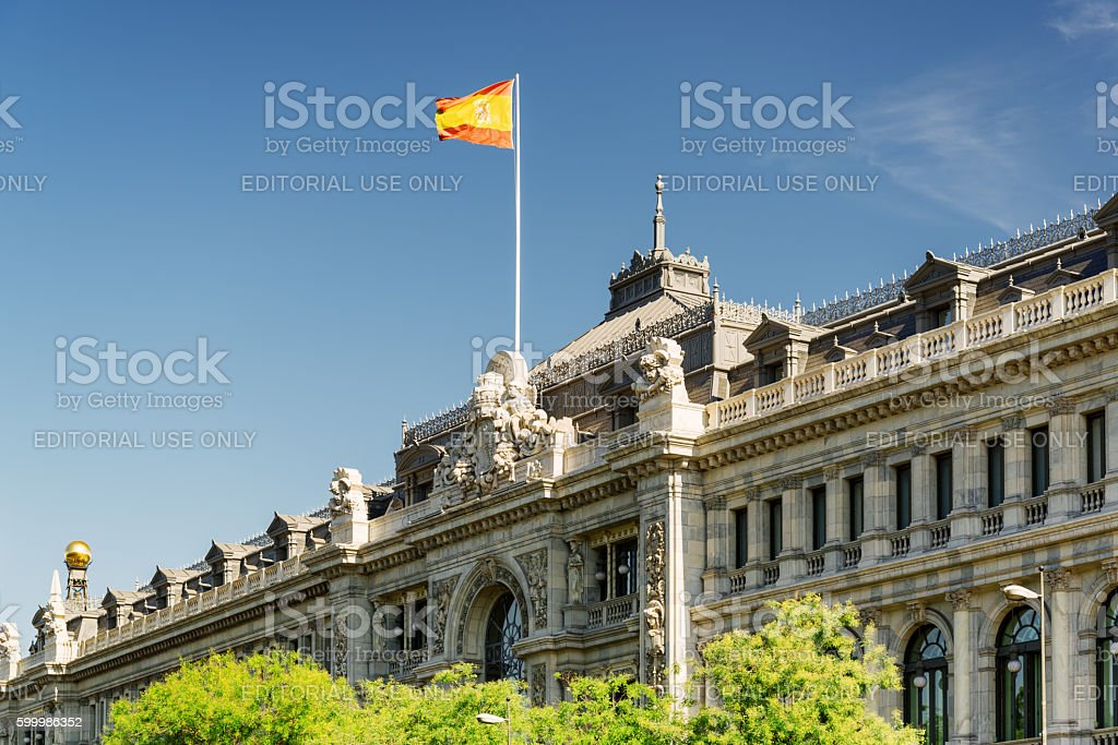 Flag of Spain fluttering on building of Bank of Spain stock photo