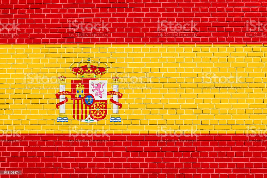 Flag of Spain on brick wall texture background stock photo