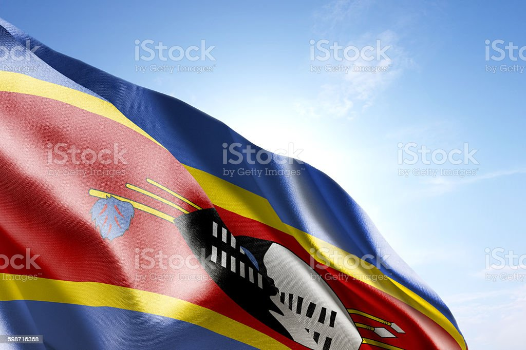 Flag of Swaziland waving in the wind stock photo