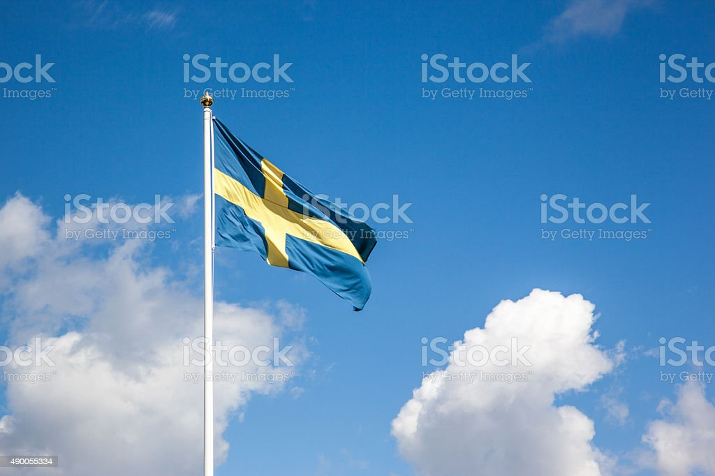 Flag of Sweden, cloudy sky stock photo
