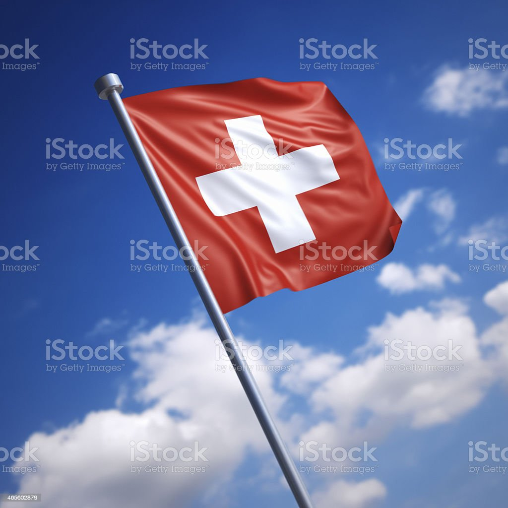 Flag of Switzerland against blue sky stock photo