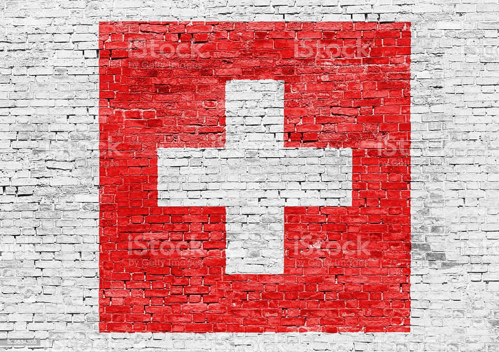 Flag of Switzerland over brick wall stock photo