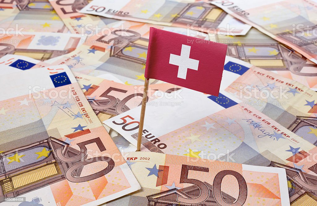 Flag of Switzerland sticking in 50 Euro banknotes.(series) stock photo