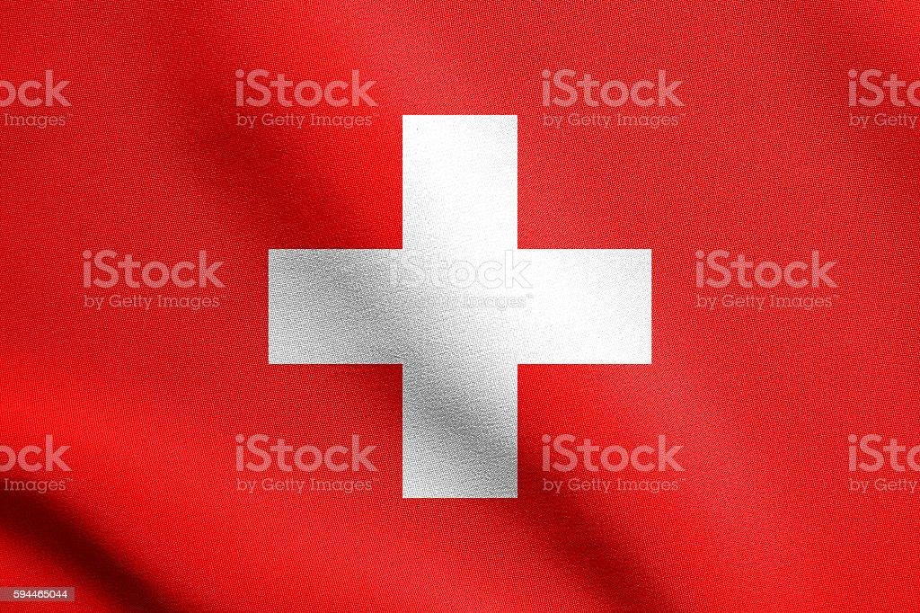 Flag of Switzerland waving with fabric texture stock photo