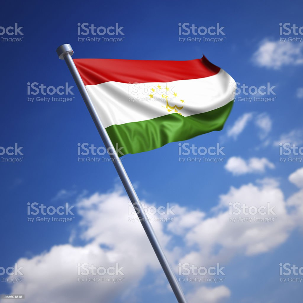 Flag of Tajikistan against blue sky stock photo