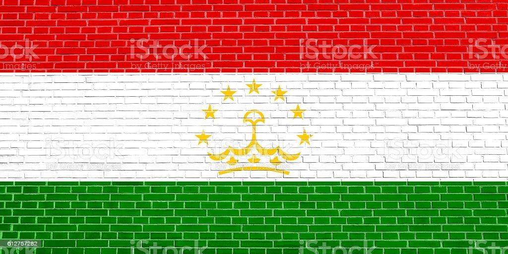 Flag of Tajikistan, brick wall texture background stock photo