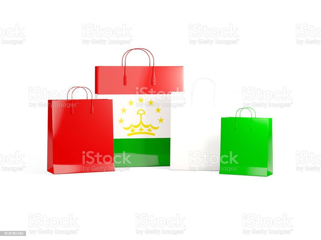 Flag of tajikistan on shopping bags stock photo