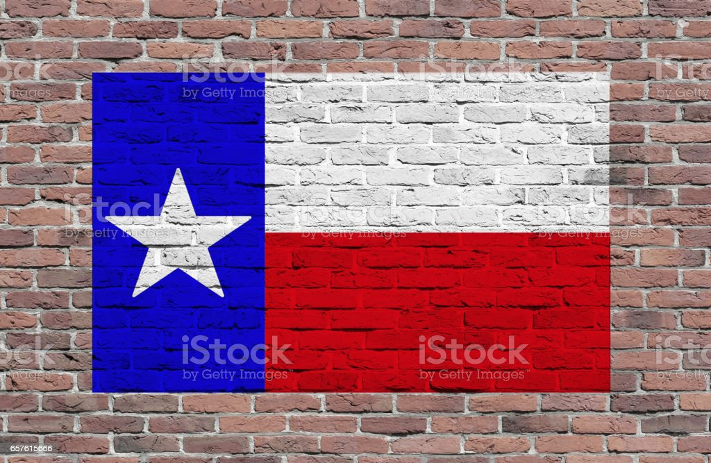 Flag of Texas State painted over brick wall stock photo