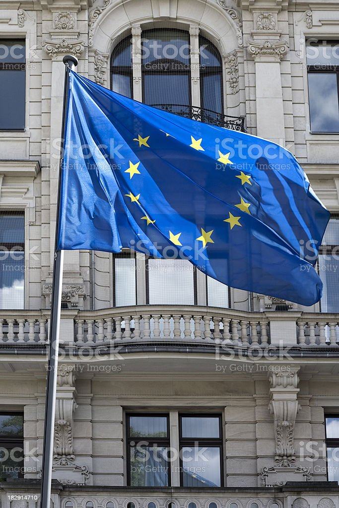 Flag of the European community in front a government building royalty-free stock photo