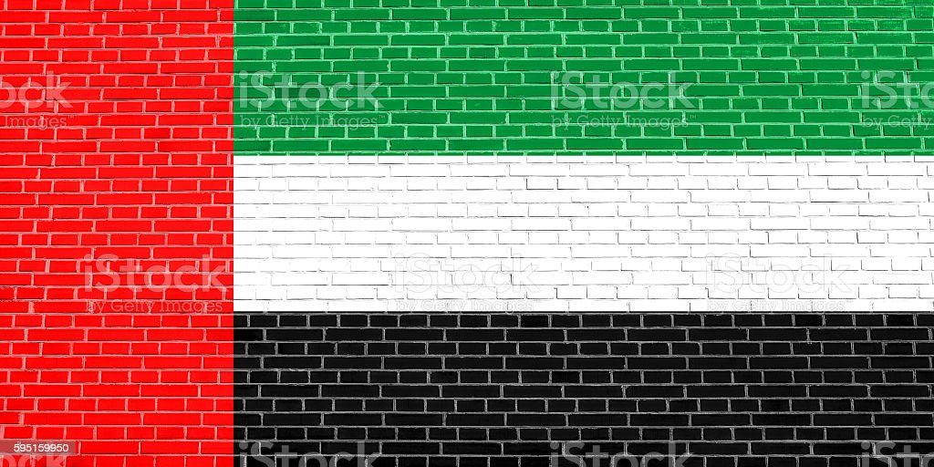 Flag of the UAE on brick wall texture background stock photo