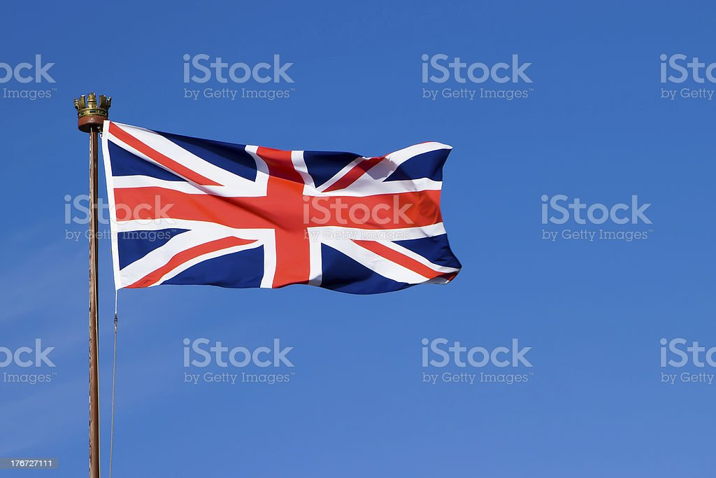 Flag of the United Kingdom on a weathered pole royalty-free stock photo