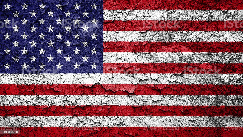 Flag of the United States of America painted cracked ground. stock photo