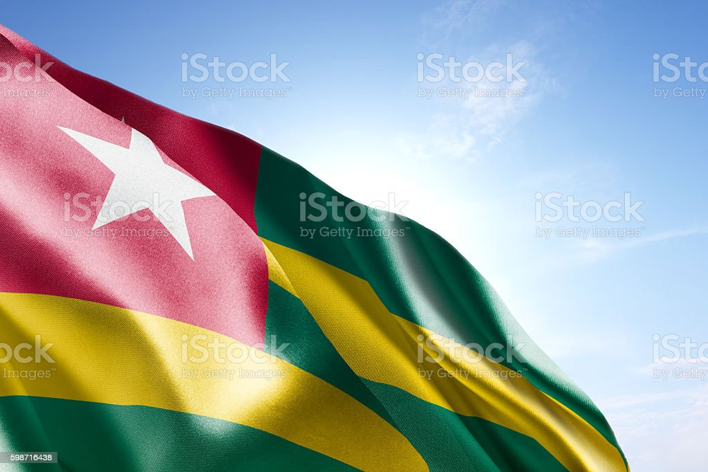 Flag of Togo waving in the wind stock photo