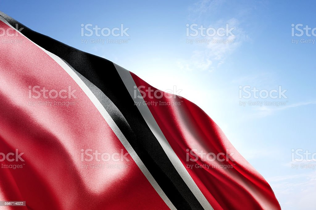 Flag of Trinidad and Tobago waving in the wind stock photo