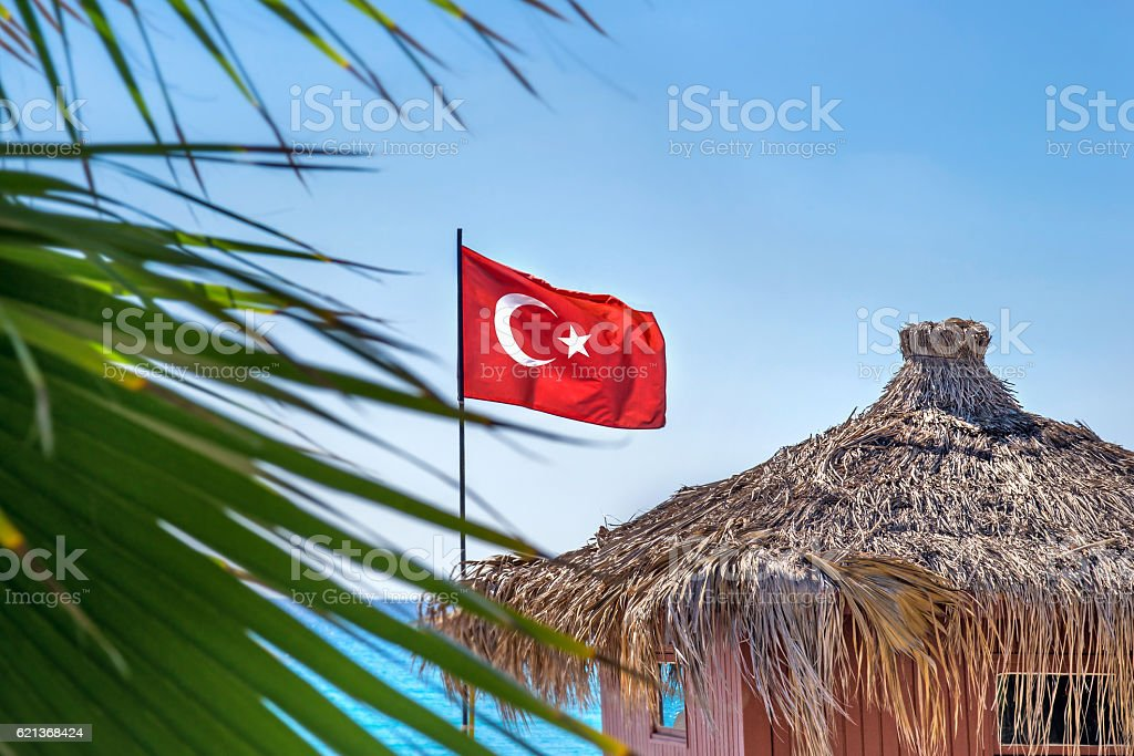 Flag of Turkey on the background of the sea stock photo