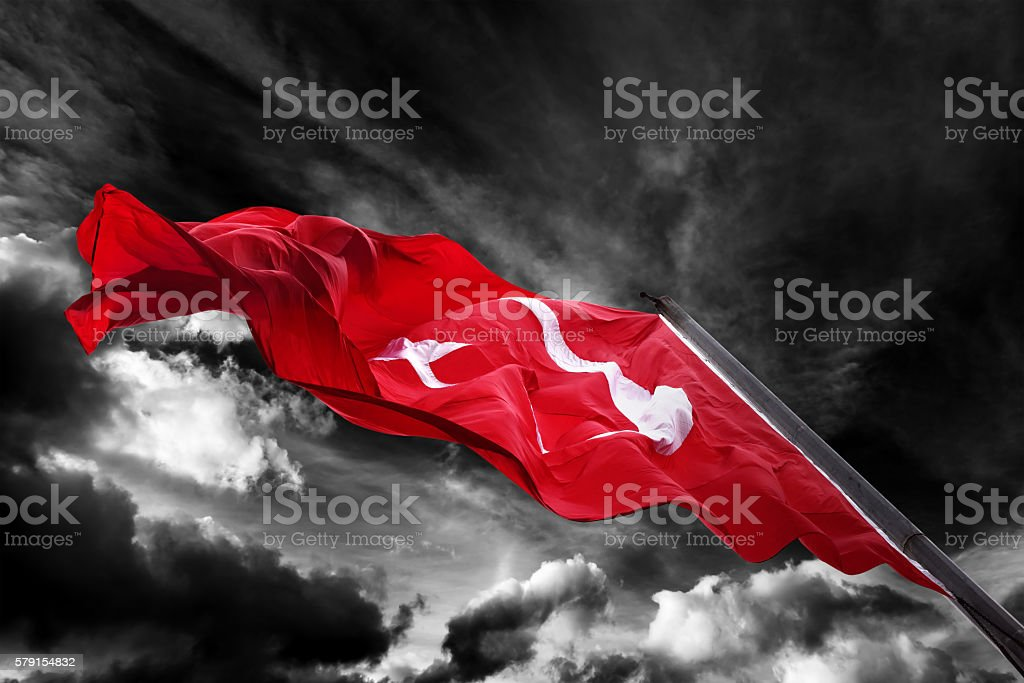Flag of Turkey waving against black and white sky stock photo