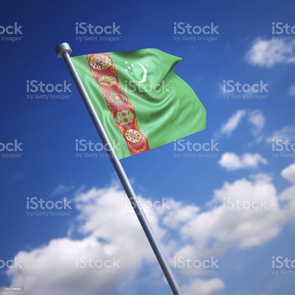 Flag of Turkmenistan against blue sky stock photo