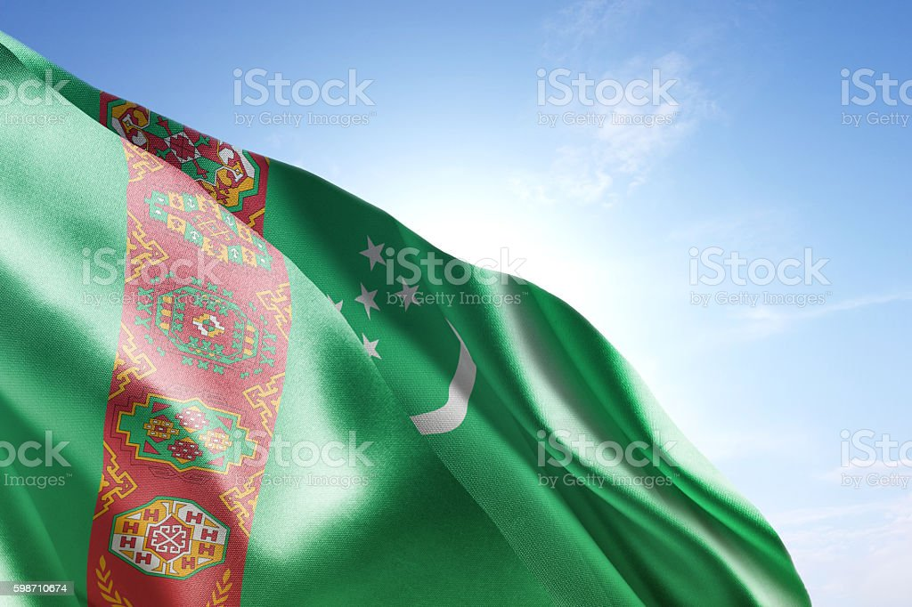 Flag of Turkmenistan waving in the wind stock photo