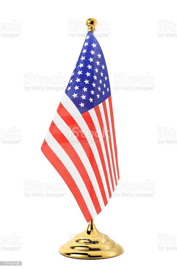 Flag of UA hanging on the gold flagpole stock photo