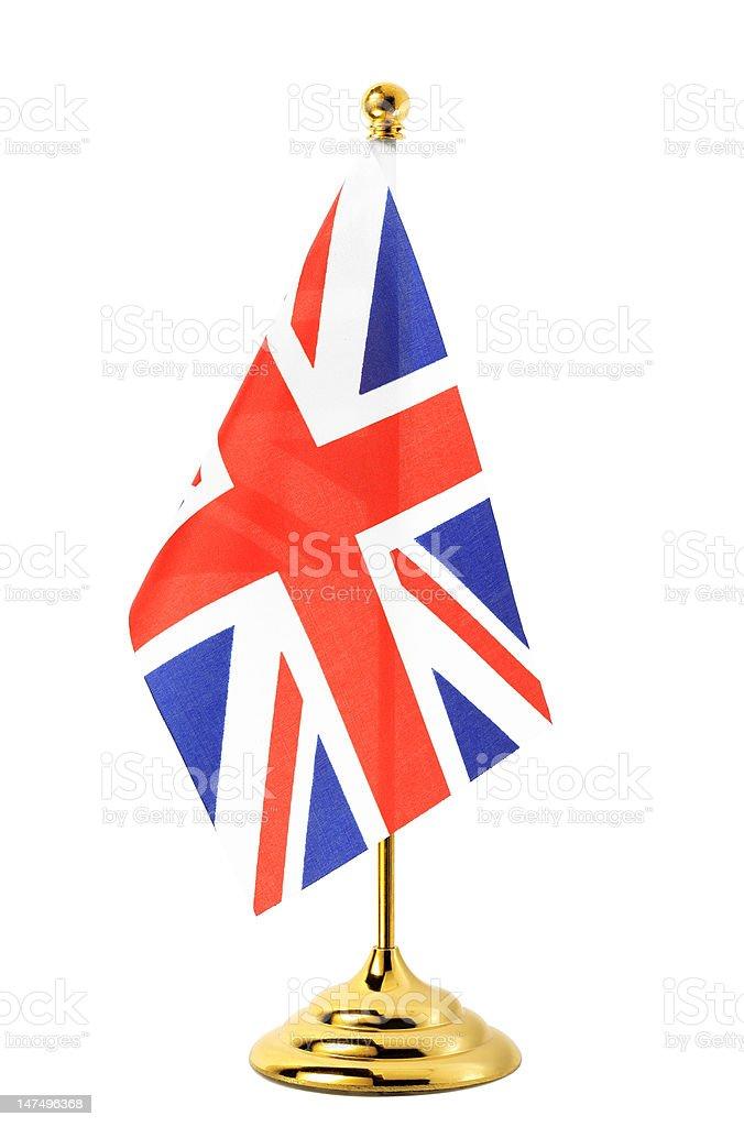 Flag of UK hanging on the gold flagpole royalty-free stock photo